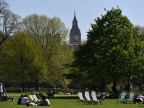 People relax in the sunshine in St James's park central London