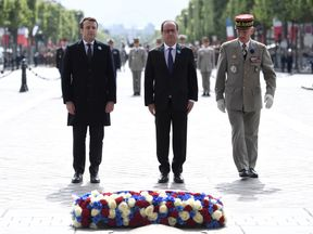 Francois Hollande (C) and French president-elect Emmanuel Macron (L) mark the 72nd anniversary of the victory over Nazi Germany during WWII