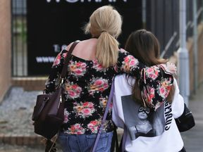 Ariana Grande concert attendees leave the Park Inn where they were given refuge after last nights explosion at Manchester Arena