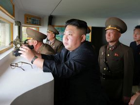 This picture released on Friday shows Kim Jong-Un inspecting a defence detachment