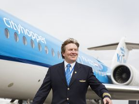 Dutch King Willem-Alexander in front of a KLM Cityhopper aircraft at Schiphol Airport, near Amsterdam