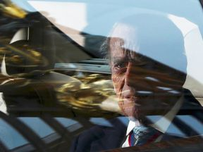 Prince Philip leaves Buckingham Palace with the Queen