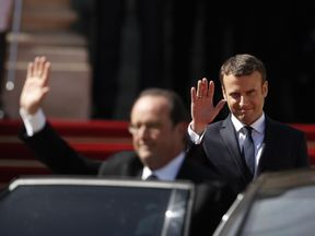 Emmanuel Macron waves off Francois Hollande as he takes over as French president