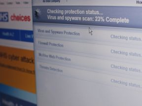 Internet security software performing an anti-virus and anti-spyware scan on a laptop