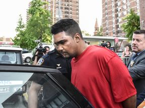 Richard Rojas is escorted from the 7th precinct by New York City Police officers after being processed in connection with the speeding vehicle that struck pedestrians on a sidewalk in Times Square in New York City, U.S. May 18, 2017
