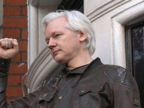 Julian Assange on the balcony of the Ecuadorian embassy