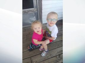 The boy, four, and his younger sister were swept away by floodwaters