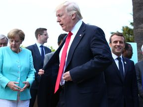 German Chancellor Angela Merkel,  with President Donald Trump and French President Emmanuel Macron