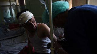 A man receives treatment for his injuries in a Kabul hospital