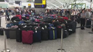 Luggage piled up after IT failure causes chaos at Heathrow Terminal 5