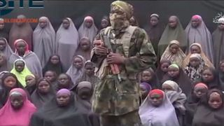 Chibok girls with a Boko Haram fighter