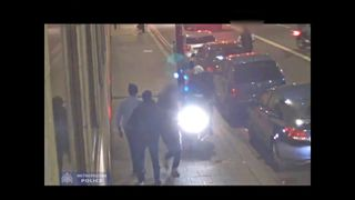 The tourist runs as the moped speeds towards him