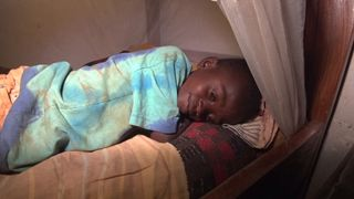 Child cobalt miner receives a real bed for the first time