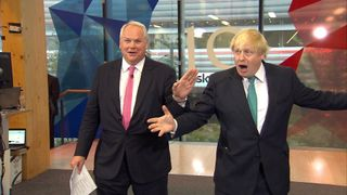 Boris Johnson is animated during a debate with Labour's Andrew Gwynne, hosted by Adam Boulton