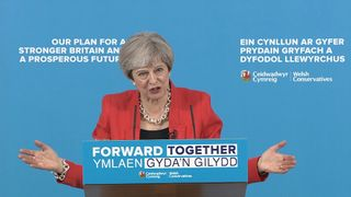 Theresa May under the cosh from reporters over the Tory social care plans