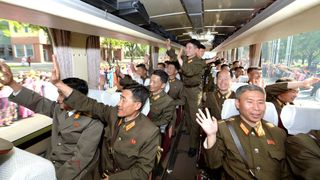 Developers of the ground-to-ground medium-to-long range strategic ballistic rocket Hwasong-12 arrive in Pyongyang