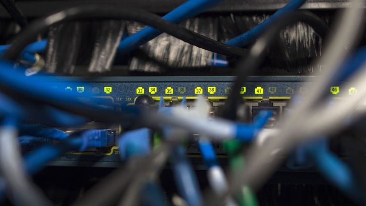Network cables are seen going into a server in an office building in Washington, DC on May 13, 2017