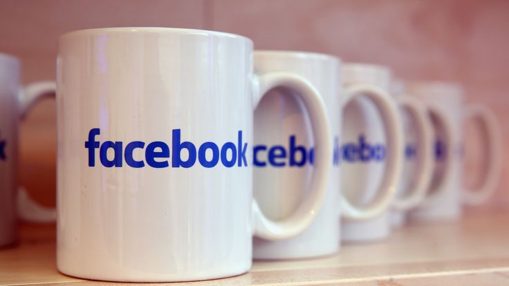 Coffee mugs adorned with the Facebook logo stand at the Facebook Innovation Hub on February 24, 2016 in Berlin, Germany. The Facebook Innovation Hub is a temporary exhibition space where the company is showcasing some of its newest technologies and projects