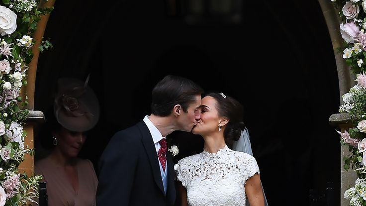 Pippa Middleton (R) kisses her new husband James Matthews