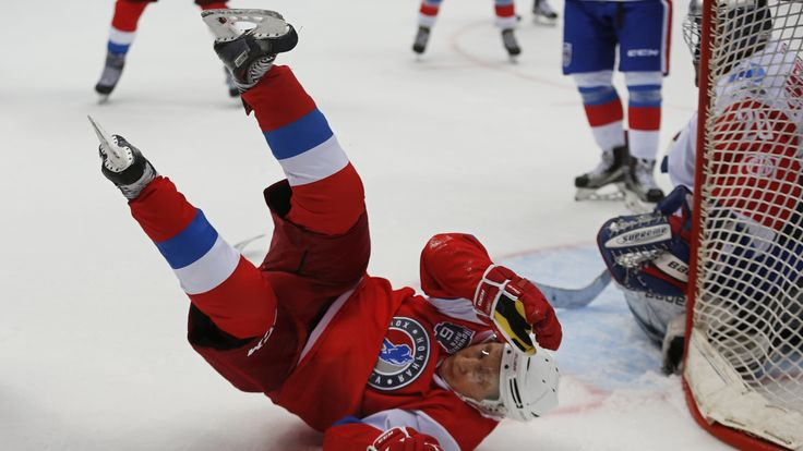 Russian President Vladimir Putin takes part in a gala match of the hockey teams of the Night League at the Shayba Olympic Arena in Sochi, Russia