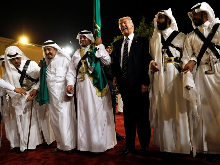 Mr Trump dances with a sword as he arrives to a welcome ceremony by King Salman