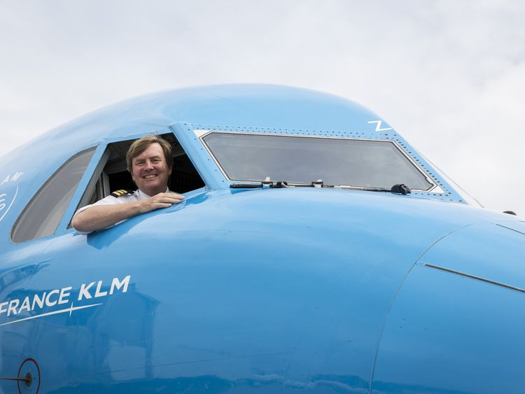 Dutch King Willem-Alexander looking out from the window of a KLM Cityhopper aircraft at Schiphol Airport, near Amsterdam