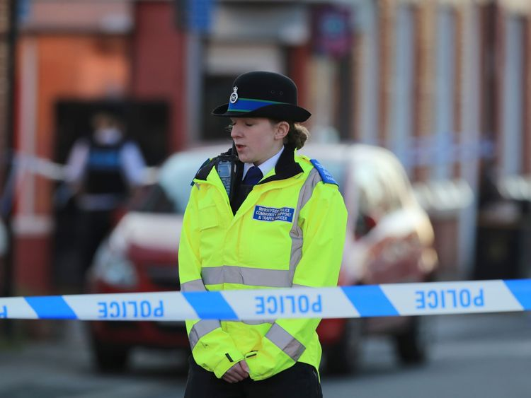 A police officer at the taped off scene of the attack