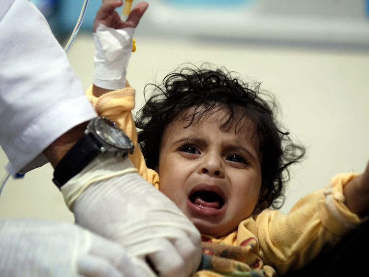 A Yemeni child receives treatment for suspected cholera at a hospital in Sanaa