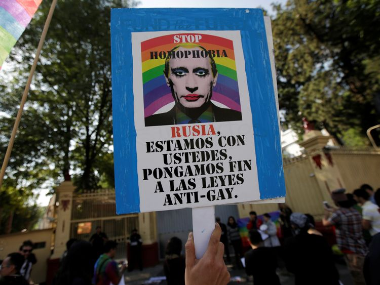 A member of the LGBT community, holds a placardduring a protest outside the Russian embassy, for the constant discrimination and violence against the gay community in Chechnya and other regions of Russia, in Mexico City, Mexico April 19, 2017