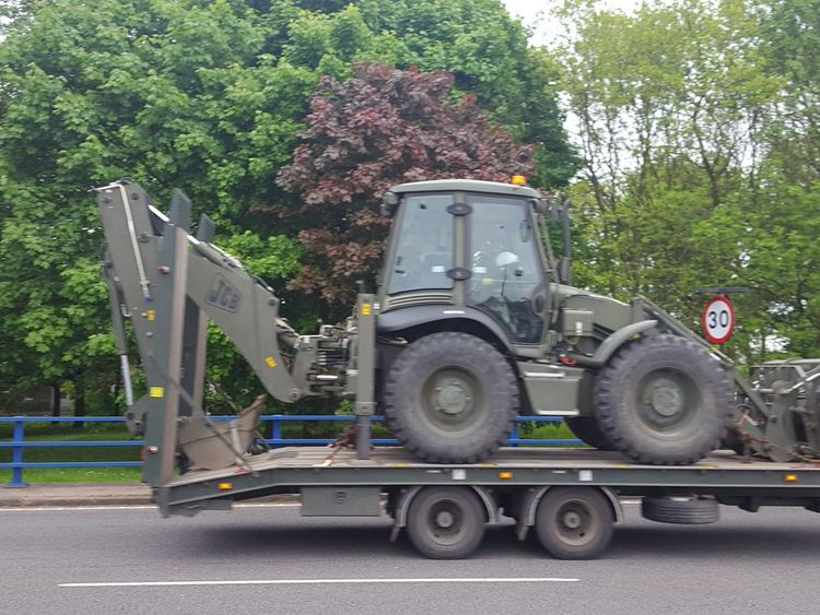 A digger is transported to the construction site. Pic: Central Motorway Police Group
