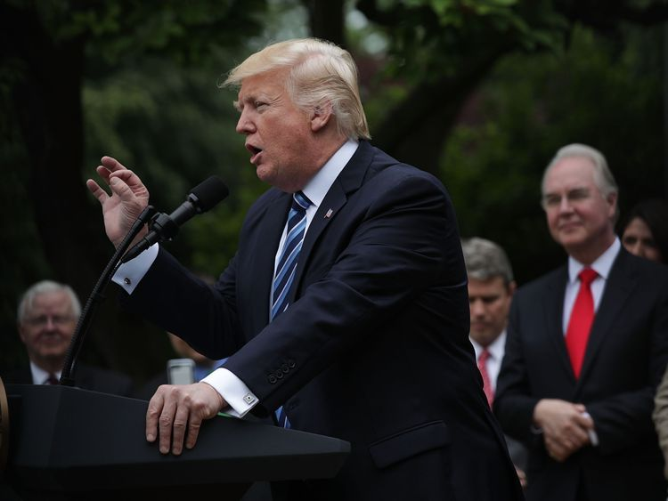 US President Donald Trump speaks as he gets a step closer to scrapping Obamacare