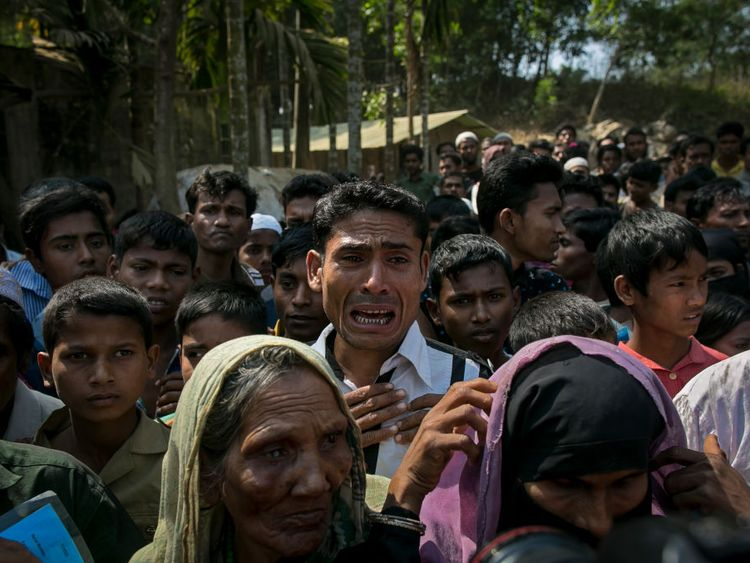 Rohingya refugees gather for aid supplies in Bangladesh in February