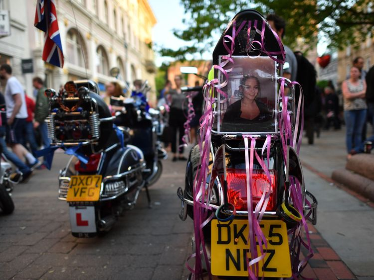 A scooter adorned with pink ribbons and a photo of Olivia Campbell