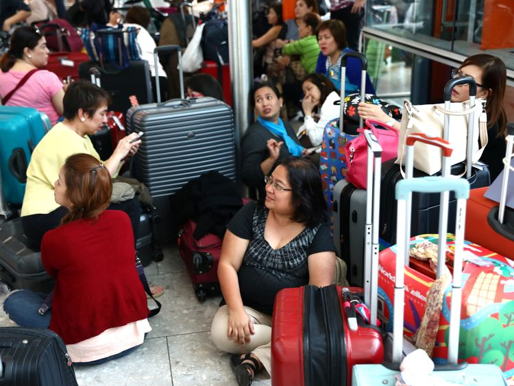 People wait with their luggage at Heathrow Terminal 5 in London, Britain May 27, 2017