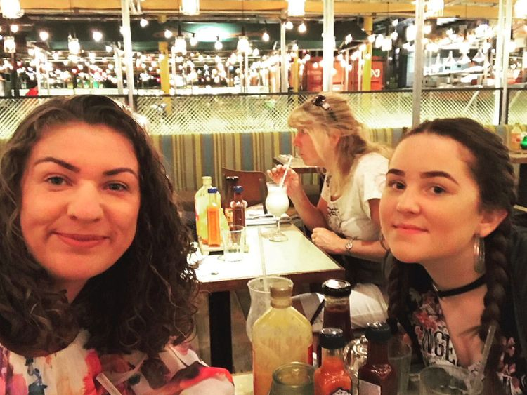 Lizzie Murtagh and her daughter Olivia enjoy drinks before the Ariana Grande concert