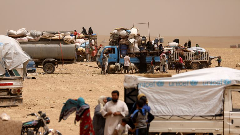 Refugees who fled from Raqqa gather at a camp in Ain Issa