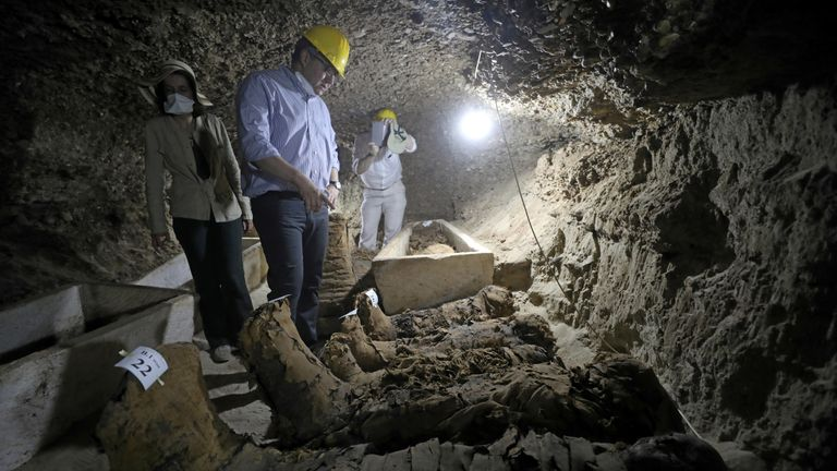 Minister of Antiquities Khaled Al-Anani inside a newly discovered burial site in Minya