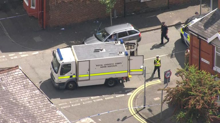 A bomb disposal van is at the scene of an ongoing search in Moss Side
