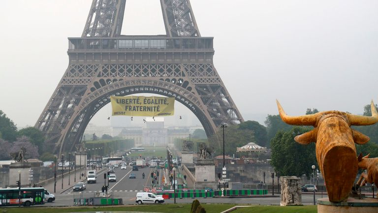 Environmental activists broke into the Eiffel Tower and unfurled a banner in protest at Marine Le Pen