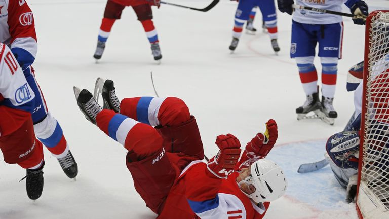 Russian President Vladimir Putin falls down during the 'Night League' teams ice hockey Gala match at the Shayba Olympic Arena in Sochi