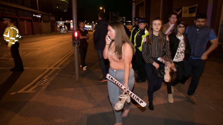 Concert goers after fleeing the Manchester Arena