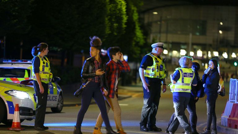 Police and fans close to the Manchester Arena after the bombing