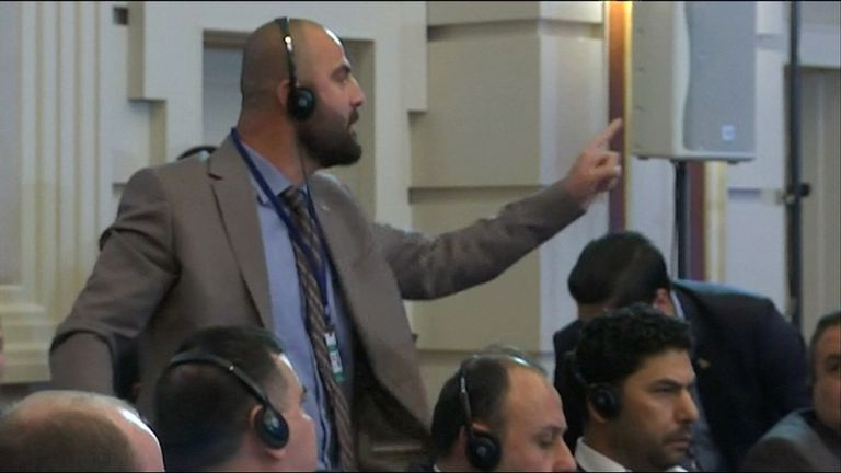 An angry delegate from a Syrian opposition group protests during the signing of a safe zone pact