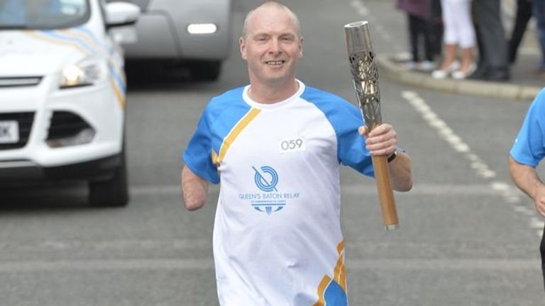 Doug McIntosh takes part in the Commonwealth Games Queen's Baton relay in 2014