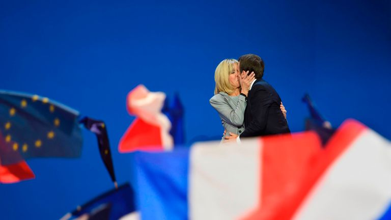 Emmanuel and Brigitte Macron celebrate after he advances to the second round of the election