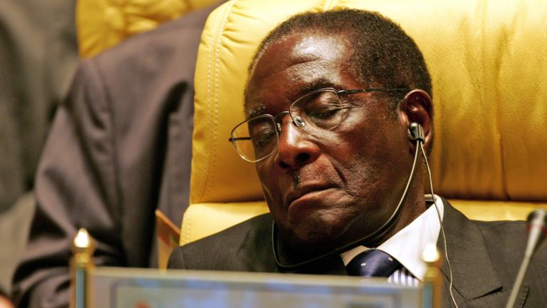 Mr Mugabe closes his eyes during an Africa Union meeting in July 2005