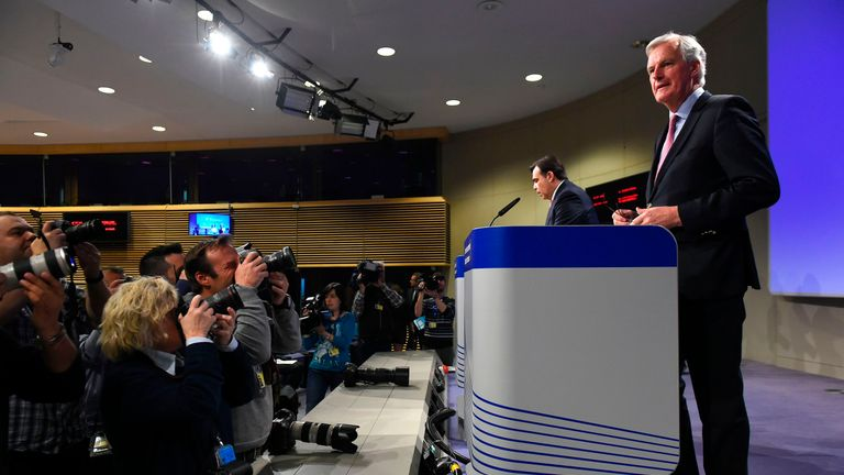 EU Brexit negotiator Michel Barnier (R), gives a joint press conference on the negotiations with the United Kingdom Council under Article 50, at the European Union headquarters in Brussels, on May 3, 2017