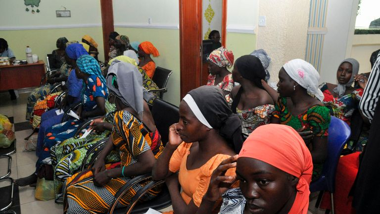 Some of the recently freed girls from Chibok wait in Abuja on May 7, 2017. Eighty-two of the more than 200 schoolgirls kidnapped by Boko Haram in northeast Nigeria in 2014 arrived in Abuja on Sunday to meet President Muhammadu Buhari after a prisoner swap deal secured their release