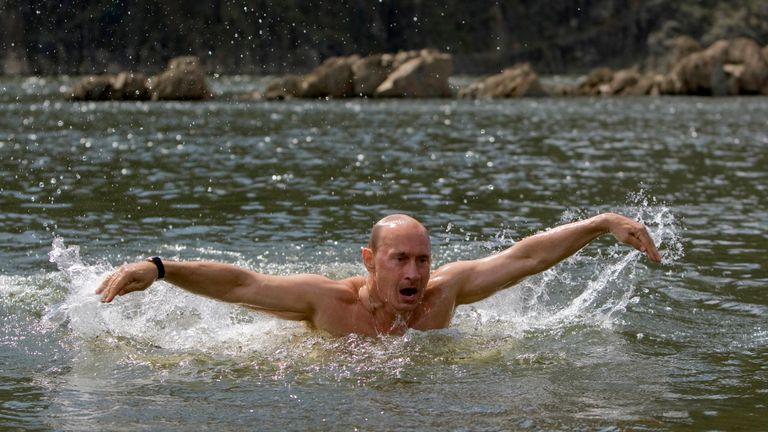 Vladimir Putin swims in a lake in southern Siberia's Tuva region in 2009