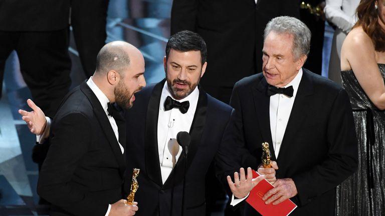 La La Land producer Jordan Horowitz (L) announces actual Best Picture winner as 'Moonlight' after a presentation error